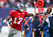 New York Giants' Wide Receiver Plaxico Burress stretches for the ball at Giants Stadium, in New Jersey.