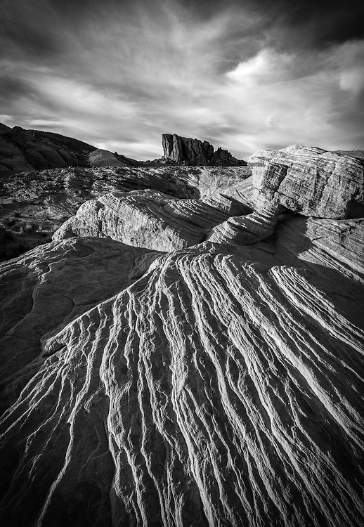 Sidelight and texture on the sandstone, Slot canyon with reflection, Valley of Fire State Park, Nevada, USA (black & white)