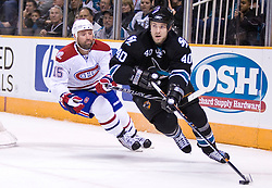 March 4, 2010; San Jose, CA, USA; San Jose Sharks defenseman Kent Huskins (40) skates past Montreal Canadiens center Glen Metropolit (15) during the first period at HP Pavilion. San Jose defeated Montreal 3-2. Mandatory Credit: Jason O. Watson / US PRESSWIRE