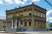 Masonic Temple building. Dawson City was the center of the Klondike Gold Rush (1896–99), after which population rapidly declined, in Yukon, Canada. Dawson City shrank further during World War II after the Alaska Highway bypassed it 300 miles (480 km) to the south using Whitehorse as a hub. In 1953, Whitehorse replaced Dawson City as Yukon Territory's capital. Dawson City's population dropped to 600–900 through the 1960s-1970s, but later increased as high gold prices made modern placer mining operations profitable and tourism was promoted. In Yukon, the Klondike Highway is marked as Yukon Highway 2 to Dawson City.