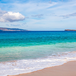 Big Beach Maui Hawaii panorama photo with Molokini Crater and Kaho'olawe Island Reserve. Big Beach is in Wailea-Makena Hawaii and is one of Maui's most popular beaches. Panoramic photo ratio is 1:3. Copyright ⓒ 2019 Paul Velgos with All Rights Reserved.