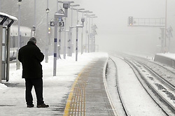 © Licensed to London News Pictures. 22/01/2013.Southeastern commuters at Pettswood station in Kent this morning brave the snow and cold fog to get to work.. Photo credit : Grant Falvey/LNP