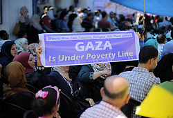 July 4, 2018 - Gaza City, The Gaza Strip, Palestine - Palestinians hold signs during a protest after the United Nations Relief and Works Agency for Palestine Refugees in the Near East (UNRWA) cut its services in front of UNRWA headquarters in Gaza City on 4 July 2018. (Credit Image: © Mahmoud Issa/Quds Net News via ZUMA Wire)