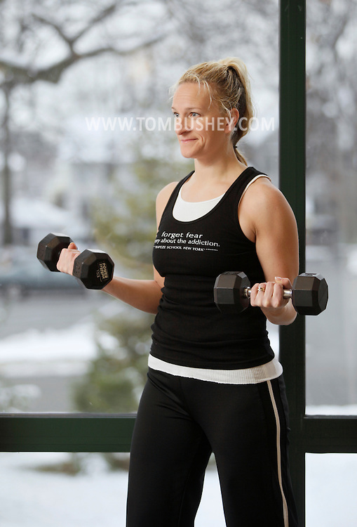 Rachel Taylor lifts weights at the Middletown YMCA on Monday, Dec. 7, 2009.