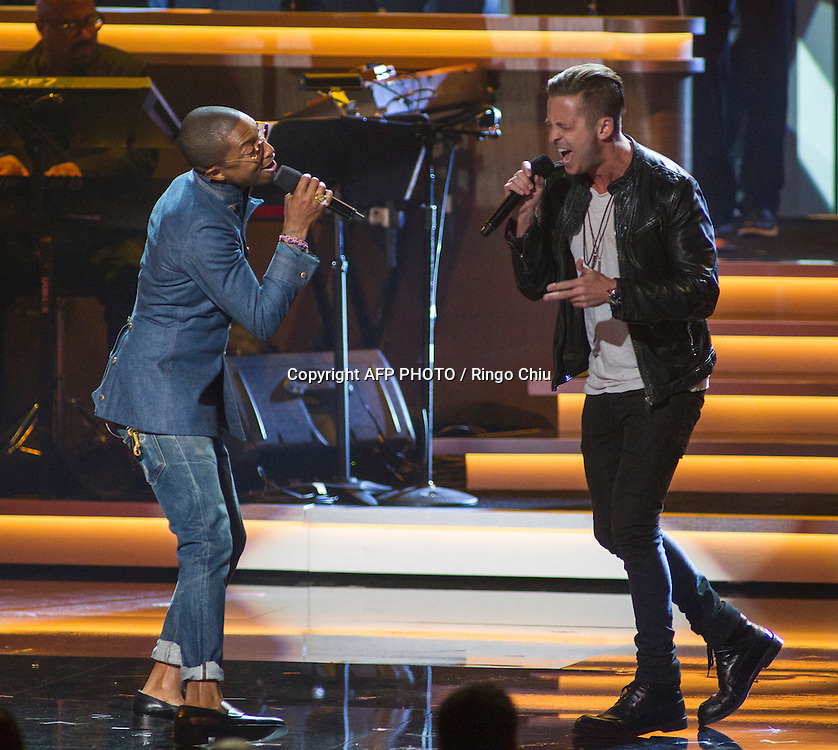 Pharrell Williams, left, and Ryan Tedder perform at a concert, Stevie Wonder: Songs In The Key Of Life - An All-Star GRAMMY Salute, at Nokia Theatre L.A. Live on February 10, 2015 in Los Angeles, California. AFP PHOTO / Ringo Chiu