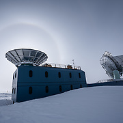Sun halo framing the BICEP3 telescope ground shield