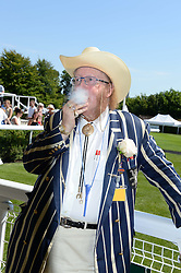 JOHN McCRIRICK at the 3rd day of the 2013 Glorious Goodwood racing festival - Ladies day at Goodwood Racecourse, West Sussex on 1st August 2013.