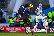 Mohamed Elneny of Arsenal (4) and Alexandre Lacazette of Arsenal (9) got for the same ball during the Premier League match between Huddersfield Town and Arsenal at the John Smiths Stadium, Huddersfield, England on 9 February 2019.