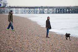 © Licensed to London News Pictures. 26/12/2014. Southsea, Hampshire, UK. A couple walking their dog today, Boxing Day, in Southsea, Hampshire. Photo credit : Rob Arnold/LNP