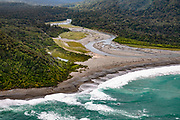 Aerial view: Kaipo River flows into the Tasman Sea in Fiordland National Park. We flew from Milford Sound to Martins Bay to start the Hollyford Track, in Southland region, South Island of New Zealand. We enjoyed an easy 3-day version of the Hollyford Track: Day 1: fly from Milford Sound to Martins Bay, walk to its oceanfront Hut, and see New Zealand fur seals. Day 2: jetboat on Lake McKerrow to Pyke River Confluence, hike to Hidden Falls Hut for overnight lodging. Day 3: tramp out to Hollyford Road end to our prearranged car shuttle. In 1990, UNESCO honored Te Wahipounamu - South West New Zealand as a World Heritage Area.