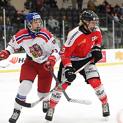 COBOURG, - Dec 18, 2015 -  WJAC Game 11- Team Czech Republic vs Team Switzerland at the 2015 World Junior A Challenge at the Cobourg Community Centre, ON. Lukas Doudera #23 of Team Czech Republic battles for control with Victor Ojdemark #3 of Team Switzerland during the second period.<br /> (Photo: Andy Corneau / OJHL Images)