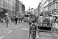 British soldiers seal off Royal Avenue, Belfast, N Ireland, following an explosion outside the former Grand Central Hotel in March 1974. The hotel  became even more of a target after it was taken over by the British Army as as a base and billet. 197403000216c.<br /> <br /> Copyright Image from Victor Patterson, 54 Dorchester Park, Belfast, UK, BT9 6RJ<br /> <br /> t1: +44 28 9066 1296 (from Rep of Ireland 048 9066 1296)<br /> t2: +44 28 9002 2446 (from Rep of Ireland 048 9002 2446)<br /> m: +44 7802 353836<br /> <br /> victorpattersonbelfast@gmail.com<br /> victorpatterson@me.com<br /> <br /> www.victorpatterson.com<br /> <br /> Please see my Terms and Conditions of Use at https://www.victorpatterson.com/page2<br /> It is IMPORTANT that you familiarise yourself with them.<br /> <br /> Images used on the Internet incur an additional cost and must be visibly watermarked i.e. © Victor Patterson within the body of the image and copyright metadata must not be deleted. Images used on the Internet have a size restriction of 4kbs and are chargeable at rates available at victorpatterson.com.<br /> <br /> This image is available only for the use of the download recipient i.e. television station, newspaper, magazine, book publisher, etc, and must not be passed on to any third party. It is also downloaded on condition that each and every usage is notified within 7 days to victorpatterson@me.com<br /> <br /> The right of Victor Patterson (or the named photographer) to be identified as the author is asserted in accordance with The Copyright Designs And Patents Act (1988). All moral rights are asserted.