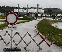 02.06.2013, Ager, Timelkam, AUT, Timelkam starke Regenfaelle, im Bild Zufahrtsstrasse zur RAG gesperrt. Starkregen sorgt derzeit vor allem in Tirol, Oberoesterreich und Salzburg für massive Überflutungen, Vermurungen und Hangrutsche // Heavy rain is currently making, especially in Tyrol, Upper Austria and Salzburg for massive flooding, mudslides and landslides, Timelkam, Austria on 2013/06/02. EXPA Pictures © 2013, PhotoCredit: EXPA/ Roland Hackl