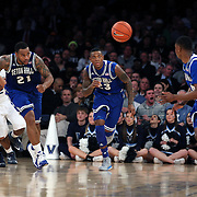 TEAGUE, Eugene Teague, (left) and  Fuquan Edwin, Seton Hall,  in action during the Villanova Wildcats Vs Seton Hall Pirates basketball game during the Big East Conference Tournament at Madison Square Garden, New York, USA. 12th March 2014. Photo Tim Clayton