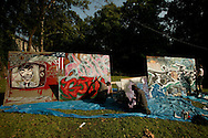 Artists paint graffiti during the Forecastle Festival in Louisville, Kentucky in 2004.