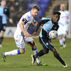 Wycombe Wanderers's Fred Onyedinma competes with Tranmere Rovers's Adam Dugdale after scoring the second goal- Photo mandatory by-line: Richard Martin-Roberts/JMP - Mobile: 07966 386802 - 03/03/2015 - SPORT - football - Tranmere - Prenton Park - Tranmere Rovers v Wycombe Wanderers - Sky Bet League Two