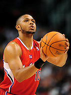 Apr. 1, 2011; Phoenix, AZ, USA; Los Angeles Clippers guard Eric Gordon (10) shoots a free throw against the Phoenix Suns at the US Airways Center. The Suns defeated the Clippers 111-98. Mandatory Credit: Jennifer Stewart-US PRESSWIRE