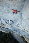 """Belayed by Alex Honnold, Tommy Caldwell free climbs the first pitch (12+/13-) of Todd Skinner's route """"Wet Lycra Nightmare,"""" on Leaning Tower, Yosemite National Park."""