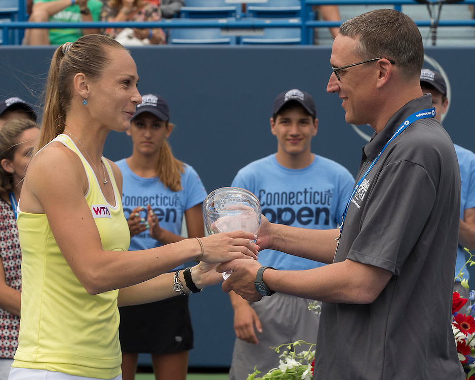 August 23, 2014, New Haven, CT:<br /> Ben Barnes of the State of Connecticut presents the finalist's trophy to Magdalena Rybarikova during a ceremony following the Singles Final on day nine of the 2014 Connecticut Open at the Yale University Tennis Center in New Haven, Connecticut Saturday, August 23, 2014.<br /> (Photo by Billie Weiss/Connecticut Open)
