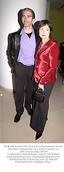 MR & MRS DAMON HILL he is the former Formula 1 World Champion racing driver, at a party in London on 25th January 2002.OWX 89