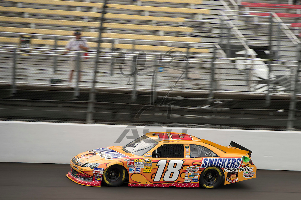 Brooklyn, MI - JUN 16, 2012: Kyle Busch driving his race car during a practice session for the Quicken Loans 400 race at the Michigan International Speedway in Brooklyn, MI.