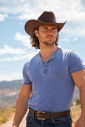 rugged hot cowboy outdoors