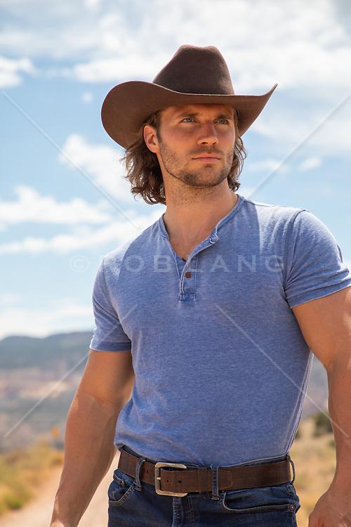 rugged hot cowboy outdoors