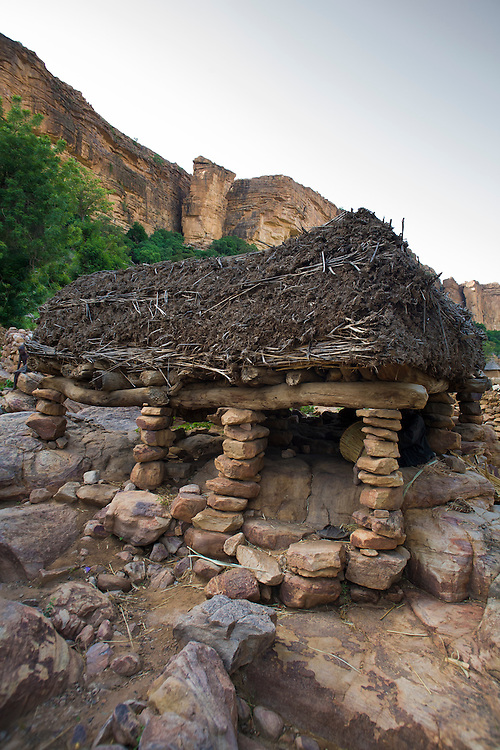 Togu na or casa palava in Doundjourou. Usually located in the centre of each village or quarter, the togu na is a shelter reserved for men, where the elders hold meetings, councils and pronounce judgements. The millet-stalk roof is normally 1.2m from the ground to prevent  standing up. The Dogon Country is the most visited part of Mali with tourists visiting its tipical  villages that can be located on the cliff, on the sandy plain or in the rocky plateau