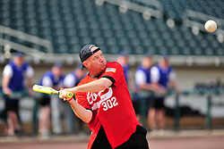 4/26/2014 Allentown, PA Allentown Firefighter Mark Kresge swings at the ball. Police Officers and Firefighters from the City of Allentown take to the field at Coca-Cola Park Saturday afternoon for a 90-minute softball game as part of Hero's Night, an IronPigs special event to promote local emergency responders. Express-Times Photo | CHRIS POST