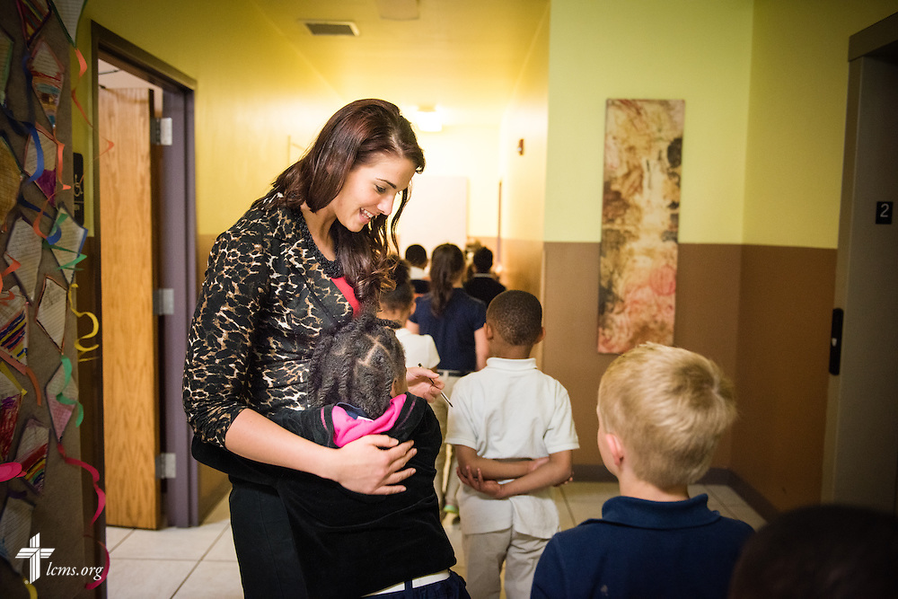 Principal Tiffany Venegas hugs students on their way to class at the Renaissance School, part of Lutheran Urban Mission Initiative, Inc., on Wednesday, May 20, 2015, in Mt. Pleasant, Wis. LCMS Communications/Erik M. Lunsford