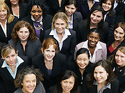 Group of business women looking up portrait elevated view close up