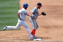 June 7, 2017 - Los Angeles, California, U.S. - Washington Nationals starting pitcher Stephen Strasburg beats Los Angeles Dodgers' Clayton Kershaw to first base for the out in the sixth inning of a Major League baseball game at Dodger Stadium on Wednesday, June 7, 2017 in Los Angeles. Los Angeles Dodgers won 2-1. (Photo by Keith Birmingham, Pasadena Star-News/SCNG) (Credit Image: © San Gabriel Valley Tribune via ZUMA Wire)