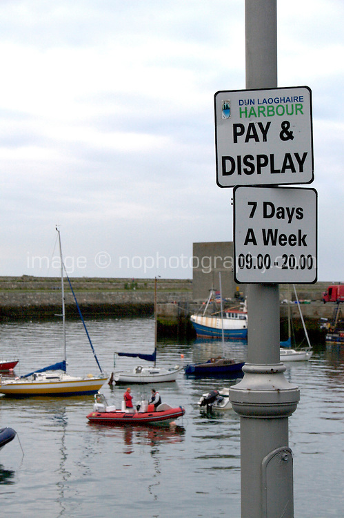 Pay and Display parking meter signs at Dun Laoghaire harbour in Dubln Ireland