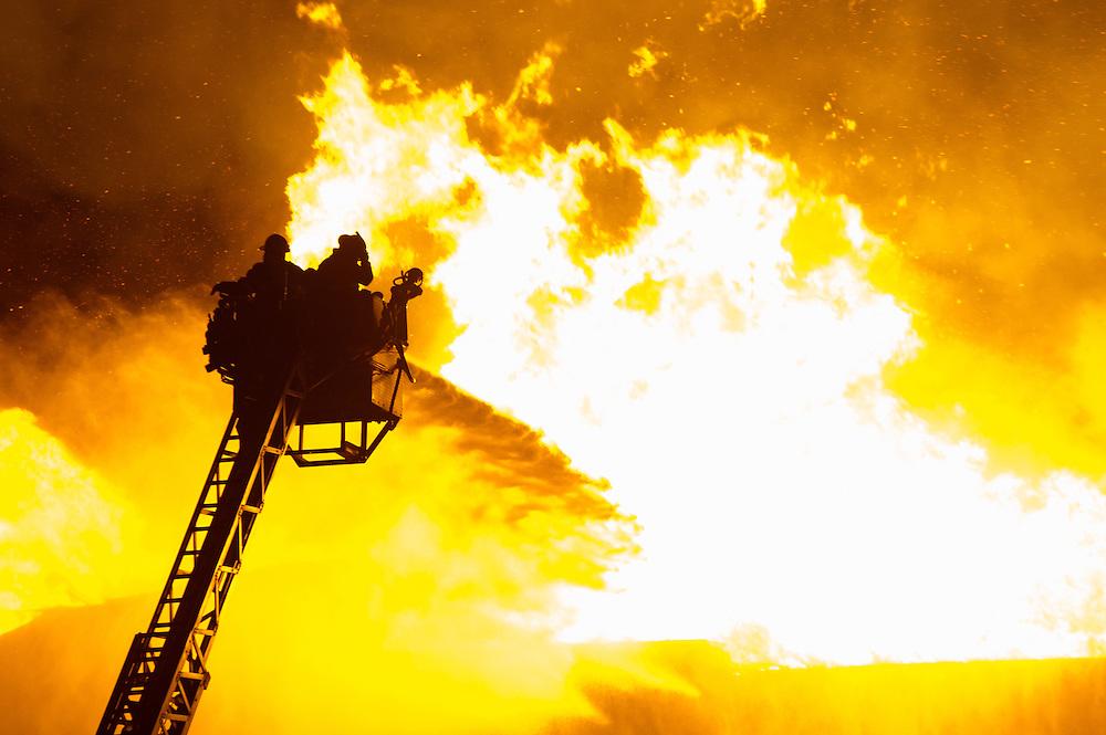 Firefighters battle the blaze at the Triple Crown Nutrition elevator in Ada, Minn., on Jan. 3.