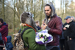 © Licensed to London News Pictures. 30/01/2016. Slough, UK. Russel Brand with Caroline Adams, 23 at the formal opening of a wooden treehouse in memory of murder victim Alice Adams in Black Park, Wexham on Saturday 30th January. The 20-year-old was stabbed to death in August 2011 with her friend and co-worker Tibor Vass, at a staff flat behind the Radisson Edwardian Hotel near Heathrow Airport. The murderer was Attila Ban, aged 32,  who also worked at the hotel as a receptionist. After the death of Alice, her family created a charity called, Alice Adams Foundation, to raise money to build the treehouse. Photo credit should read: Emma Sheppard/LNP