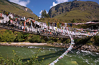 BU00005-00...BHUTAN - Famous chain link bridge, first made by the Iron Bridge Lama, (Thangtong Gyalpo (1385-1464)), over the Paro River. The bridge has been remade using some of the original chain links.
