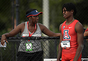 Jun 22, 2019; Miramar, FL, USA; Phillip Austin of Arizona (right) talks with Wildcats assistant coach Francesca Green during the long jump at the  USATF U20 Championships at Ansin Sports Complex. Austin won at  25-4 3/4 (7.74m).
