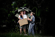 Chad Perillard, with his son Preston, 3, is told by a Collier County deputy he can't panhandle on the side of the street anymore. While there is no law against panhandling in Collier County, the deputy said they were disrupting the flow of traffic at a busy stoplight. Greg Kahn/Staff.