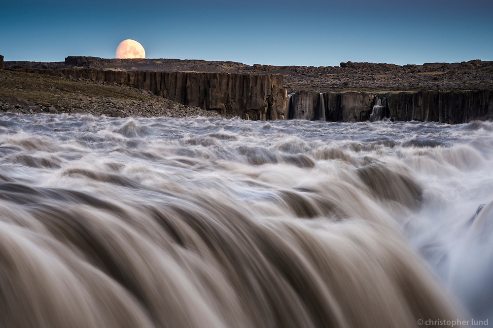 Dettifoss waterfall just after sunset. The waterfall is in Vatnajökull National Park, Northeast Iceland. The falls are 100 metres (330 ft) wide and have a drop of 45 metres (150 ft) down to the Jökulsárgljúfur canyon. It is the largest waterfall in Europe in terms of volume discharge, having an average water flow of 193 m3/s.