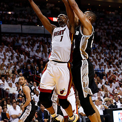 Jun 18, 2013; Miami, FL, USA; Miami Heat center Chris Bosh (1) shoots against San Antonio Spurs power forward Tim Duncan (21) during the first quarter of game six in the 2013 NBA Finals at American Airlines Arena.  Mandatory Credit: Derick E. Hingle-USA TODAY Sports