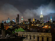 A nighttime rooftop view of New York City