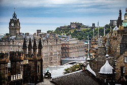 The Balmoral Hotel and Calton Hill from the esplanade on Edinburgh Castle.