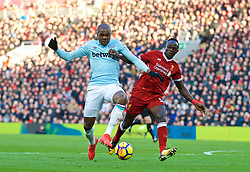 LIVERPOOL, ENGLAND - Saturday, February 24, 2018: Liverpool's Sadio Mane and West Ham United's Angelo Ogbonna during the FA Premier League match between Liverpool FC and West Ham United FC at Anfield. (Pic by David Rawcliffe/Propaganda)