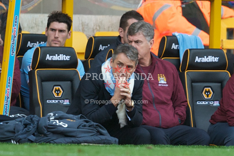 WOLVERHAMPTON, ENGLAND - Saturday, October 30, 2010: Manchester City's manager Roberto Mancini watches as his side crash to a 2-1 defeat to Wolverhampton Wanderers during the Premiership match at Molineux. (Pic by: David Rawcliffe/Propaganda)