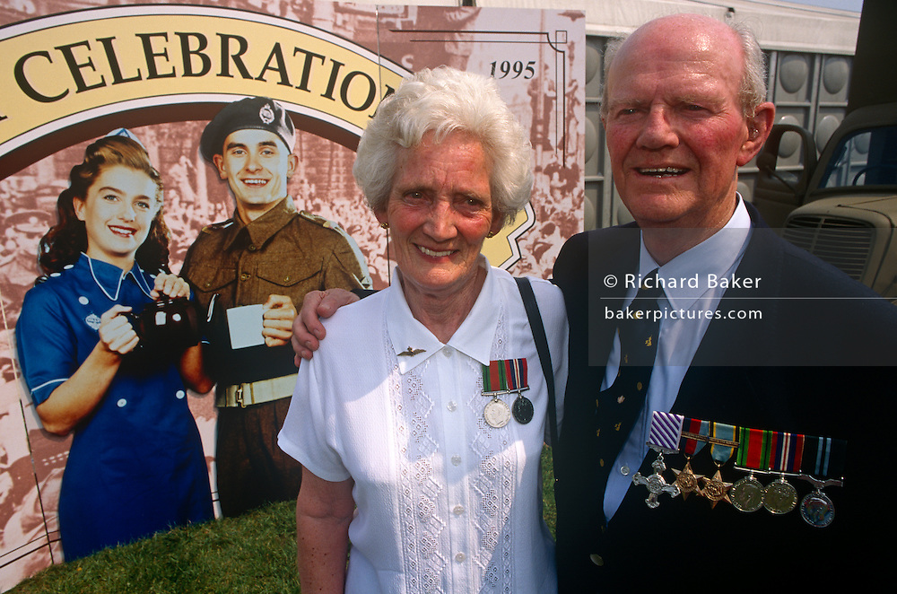 Married couple and veterans with medals of the second world war during 50th aniversary of wartime VE Day in London.