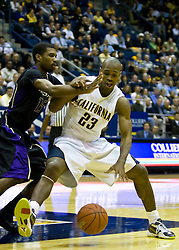 February 11, 2010; Berkeley, CA, USA;  California Golden Bears guard Patrick Christopher (23) is defended by Washington Huskies guard Scott Suggs (15) during the first half at the Haas Pavilion.  California defeated Washington 93-81.