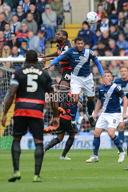 Queens Park Rangers striker Jay Emmanuel-Thomas and Birmingham City midfielder David Davis challenge for a header during the Sky Bet Championship match between Birmingham City and Queens Park Rangers at St Andrews, Birmingham, England on 17 October 2015. Photo by Alan Franklin.