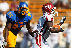 September 24, 2011; San Jose, CA, USA;  New Mexico State Aggies running back Kenny Turner (3) rushes past San Jose State Spartans defensive end Mohamed Marah (26) for a touchdown during the third quarter at Spartan Stadium. San Jose State defeated New Mexico State 34-24.