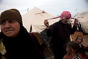 Syrian refugee Abu Moa'ad with his family by their tent  at the  Al-Zaatri refugee camp in the Jordanian city of Mafraq, near the border with Syria ,February 5,2013. He fled with his family from Daraa, Syria after his son and daughter were killed by snipers .He was smuggled into Jordan by car and then by walking to the border ...Jordan announced on Tuesday that the number of Syrian refugees in the country is expected to exceed 700, 000 in 2013, the state-run Petra news agency reported. (Photo by Heidi Levine/Sipa Press).