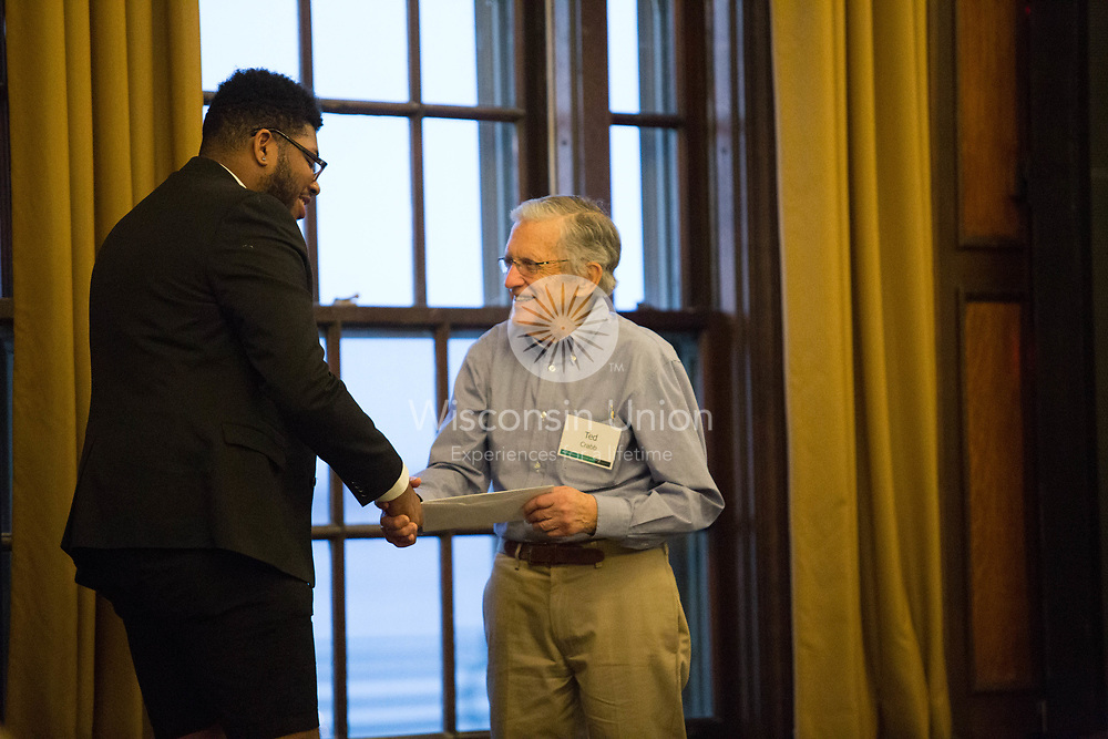 "On Thursday, April 26, 2018, The Wisconsin Union hosted the 111th annual exchange of student leadership.  This annual tradition recognizes the work of the most recent leadership with an awards ceremony and reception.  Then the ""exchange of the gavel"" occurs during the Beefeaters' Dinner in Tripp Commons.  Many past alums, Wisconsin Union Association members and Directorate members celebrate together.  Director Emeritus, Ted Crabb, presents and award to 1718 Publications Commitee Director, L. Malik Anderson."